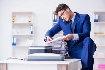 Businessman making copies in copying machine