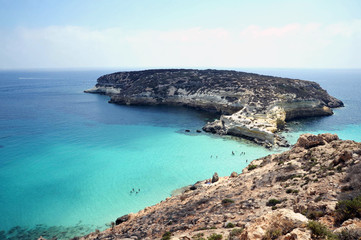 Lampedusa, Italy - August/25/2010 : tourists in rabbit island beach