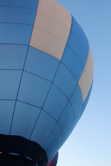 sky blue and white hot air balloon floating up to the clear blue sky
