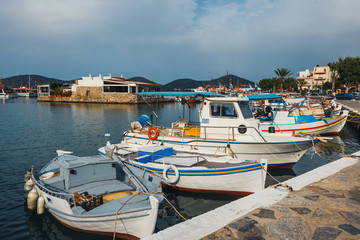 Ships and fishing boats in the harbor of Elounda, Crete, Greece