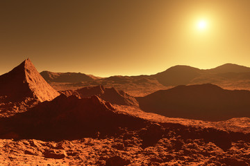 Mars - red planet - landscape with huge crater from impact and mountains in the distance during sunrise or sunset