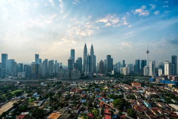 Fotomurales - Cityscape of Kuala Lumpur Panorama at morning. Panoramic image of skyscraper at Kuala Lumpur, Malaysia skyline at sunrise.
