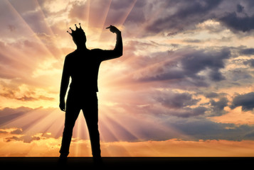 A silhouette of a narcissistic man with a crown on his head shows his finger on himself. He tries to attract attention