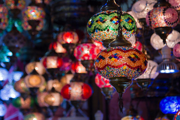 View of traditional bright decorative hanging Turkish lamps and colourful lights with vivid colours  in the Grand Bazaar. Istanbul. Turkey. Most popular souvenirs for tourists.