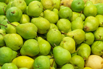 "A pile of green ""Williams"" pears in store as background, texture"