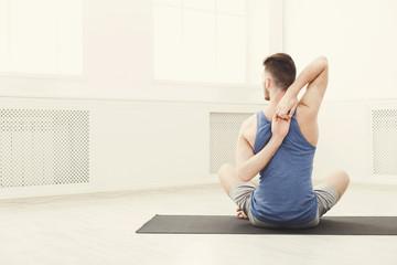 Man training yoga copy space