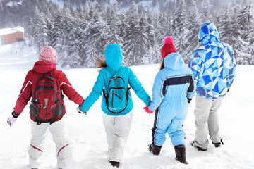 Group of friends travelling in snowy countryside. Winter vacation