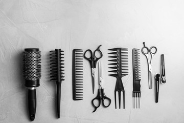 Flat lay composition with professional hairdresser tools on grey background