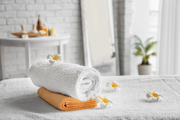Towels on massage table in spa salon