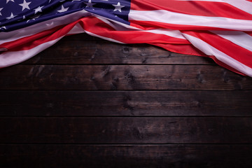 The American Flag Laying on a Wooden Background