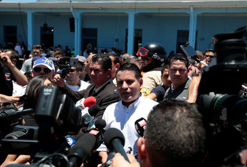 Presidential candidate of the National Restoration party, Fabricio Alvarado Munoz, speaks with journalists after casting his ballot during the presidential election in San Jose