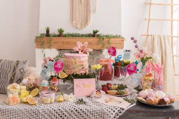 Baby shower party and cake, candies, marshmallows, cakepops, fruits on dessert table