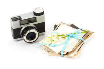 Vintage film photo-camera and old photos .