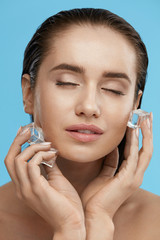 Beauty Treatment. Woman With Ice Cubes