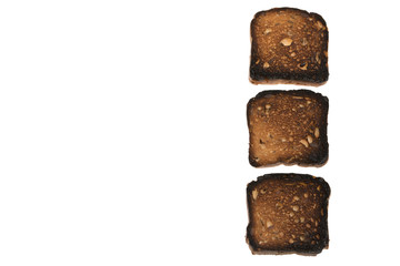 Burned bread with seeds located vertically isolated on a white background