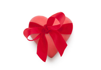 Red heart with red ribbon isolated on white background
