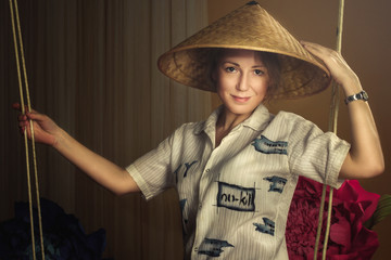 Young woman in Vietnamese hat