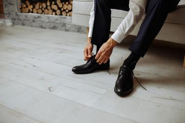man preparing for wedding. shoes