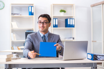 Handsome businessman employee sitting at his desk in office