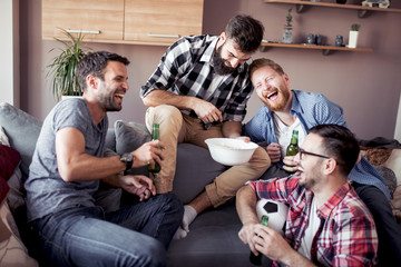 Happy male friends drinking beer