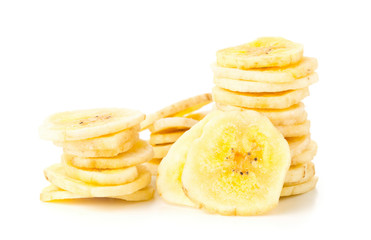 Dried banana chips snack stacked over white