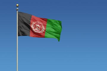 Flag of Afghanistan on a clear blue sky