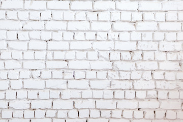 White brick wall background. Texture of a stone wall. Brick wall dyed in white color