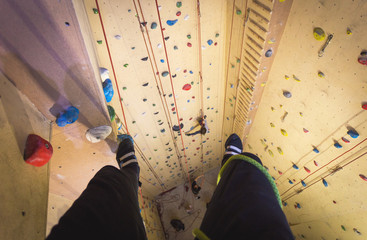 First person view from climbing wall during bouldering.