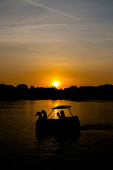enjoy with swan pedal boat at sunset
