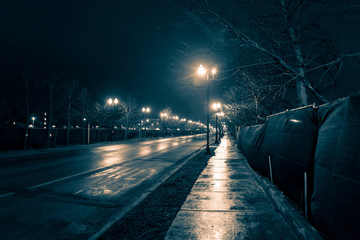 Wall Mural - Empty dark and wet urban city street road after rain at night
