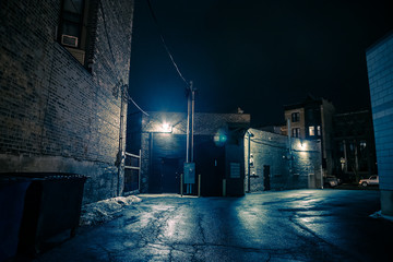 Wall Mural - Dark and eerie urban city alley at night.