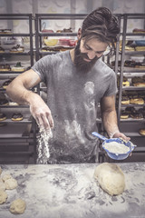 Man spilled flour on the table,selective focus