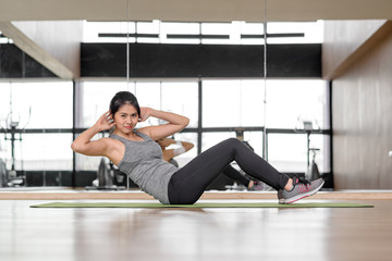 Asian woman doing abs crunches exercise