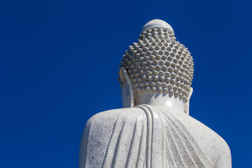 Thailand. the island of Phuket. Buddha statue. White Buddha statue against the blue sky. Buddhism.
