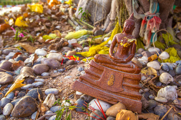 Figurine of the Buddha. A place to offer gifts. A small Buddha statue. Religions of the world. Religious Ornaments.