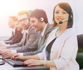 female customer service representative and colleagues in the cal