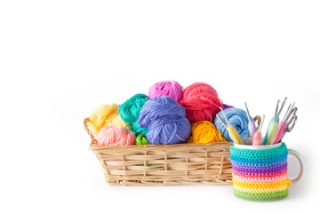 Colored cotton yarn for knitting in a basket. Isolate.