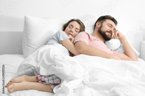 . Husband and wife sleeping in bed at home  Stock photo and royalty