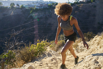 athletic african american woman walking runyon canyon