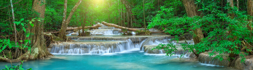 Tuinposter Watervallen Panoramic beautiful deep forest waterfall in Thailand