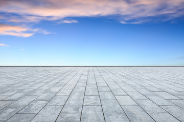 empty square floor and sky clouds at sunset