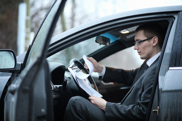Man in a business suit in the car