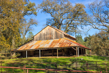 Old Wooden Barn With Rusty Tin Roof Overhang