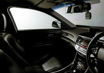 Clean console modern car, black indoor design, copy space and mobile phone.