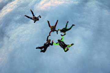 Skydivers are training in the sky.