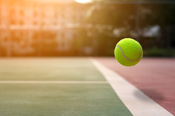 Close up tennis ball on the courts background