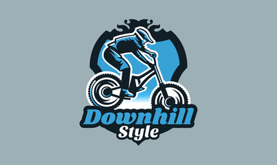 Colorful emblem, badge, logo of a rider on a mountain bike. Bicycle, transport, downhill, freeride, extreme, sports. T-shirt printing, vector illustration.