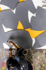 Artist's painting process . Caucasian artist working in studio