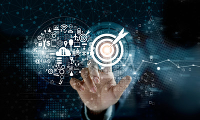 Businessman touching target with digital marketing icons on network connection background. Business innovation technology concept