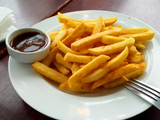 French fries on plate with the sauce